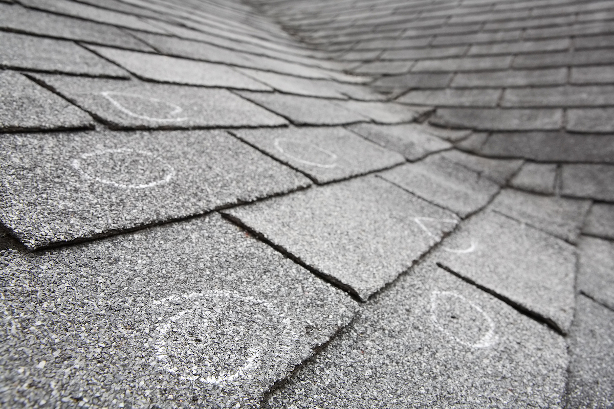 bigstock-Old-roof-with-hail-damage-cha-16442648